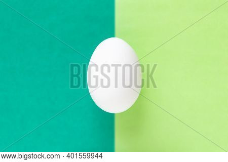 White Egg On Colorful Bright Green Split Background