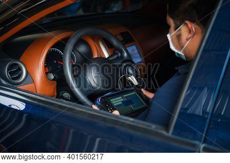 Checking A Car Engine Obd For Repair At Car Garage