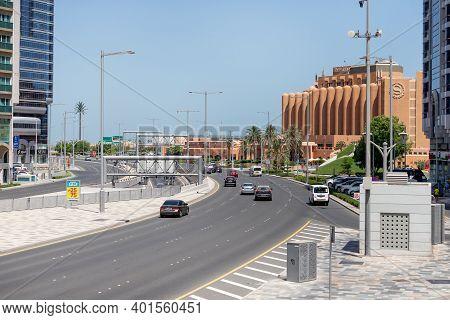 Abu Dhabi, Uae - June 18, 2020: Traffic On Salam Street Facing Corniche During The Day, Elevated Vie