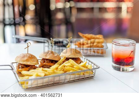 Mini Burgers With French Fries And Cocktail Served At The Bar, Finger Food