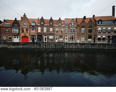 Panoramic View Of River Canal Channel In Historic City Center Of Bruges West Flanders Flemish Region