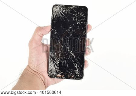 Cracked Screen Smartphone In Hand Isolated On White Background, Broken Smartphone