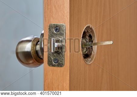 The Spindle Of The Doorknob Mechanism Is Visible From The Back Of The Wooden Interior Door When The