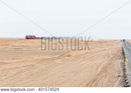 A Train Next To Road C14 Between Swakopmund And Walvis Bay