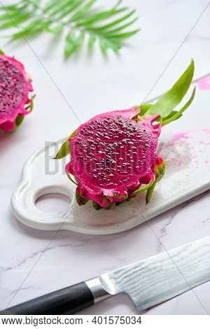 Pink Dragon Fruit, Pitaya Or Pitahaya Cut In Cubes On White Plate. Trendy Superfood Ingredient. Palm