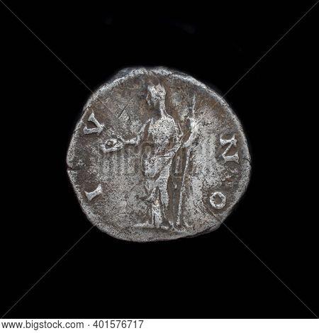 Roman Silver Denarius Isolated On Black Background. Ancient Roman Silver Coin. Faustina Ii Silver De