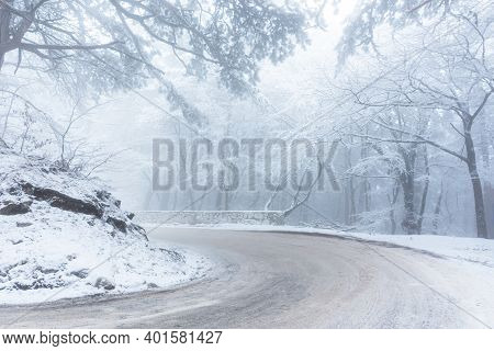 A Road In The Winter Forest. Beautiful Winter Landscape With Coniferous Forest And Mountain Serpenti