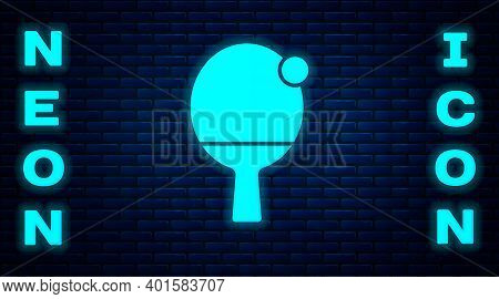 Glowing Neon Racket For Playing Table Tennis Icon Isolated On Brick Wall Background. Vector