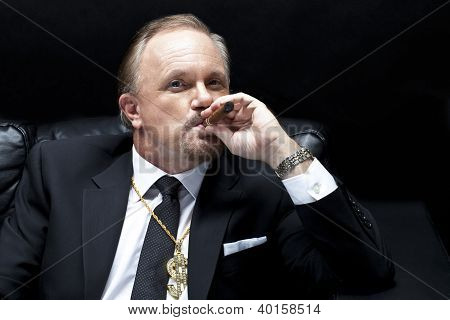 Mature Businessman Smoking Cigar