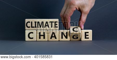 Climate Change Symbol. Hand Flips A Cube And Changes Words 'climate Change' To 'climate Chance'. Bea