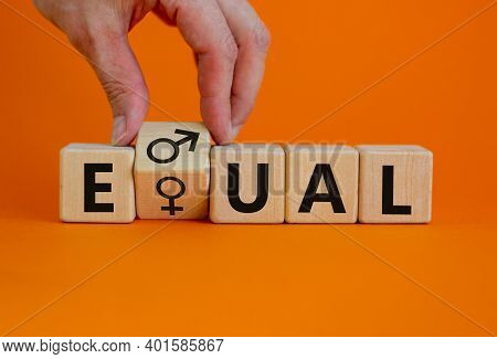 Gender Eduality Symbol. Male Hand Turns Wooden Cube With Male And Female Symbol. Equal Word. Busines