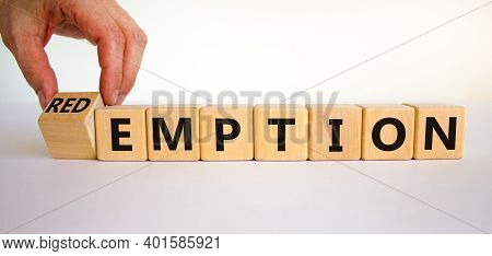 Redemption Or Emption Symbol. Male Hand Turns A Wooden Cube And Changes The Word 'emption' To 'redem
