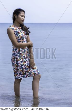 Young Indonesian Girl With Sunglasses Standing In The Sea