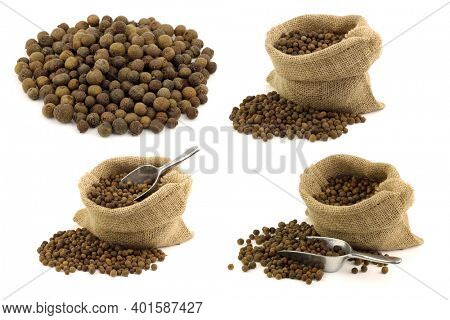 dried allspice(Jamaica pepper) and some in a burlap bag on a white background