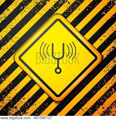 Black Musical Tuning Fork For Tuning Musical Instruments Icon Isolated On Yellow Background. Warning