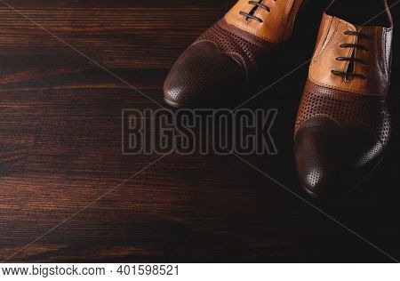 Mens Brown Shoes On A Wooden Background