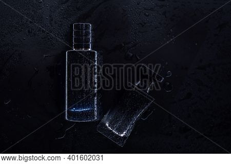 Two Black Perfumes On A Dark Background