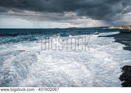 Rough Seas From Storm Bella Wash Onto The Rocky Mediterranean Coastline At Punta Caldanu In The Bala