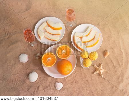 Plates With Oranges And Melon, Orange Sorbet Ice Cream In Waffle Cones, Glasses Of Rose Champagne, S
