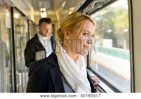 Woman in train looking pensive on window smiling travel commuting poster