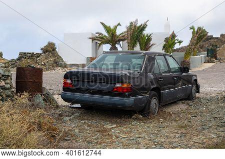 Folegandros Island, Greece - 24 September 2020: Old Car Wreck Abandoned On The Sidelines.