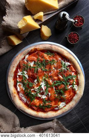 Pizza With Red River Fish. Traditional Italian Pizza. Metal Plate For Serving. A Piece Of Parmesan A