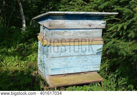A Closeup Shot Of An Old Wooden Beehive.