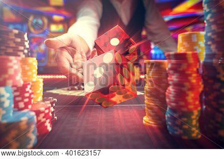 Man gambling at the craps table at the casino - Selective focus