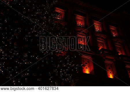 Dark Night At Paradeplatz At Christmastime. Illuminated Windows With Big Christmas Tree. Zurich, 19.