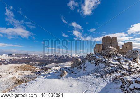 Rocca Calascio Under The Snow On A Sunny Day, In The Background The Gran Sasso And Monti Della Laga