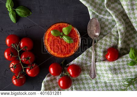 Gazpacho Soup On Black Background, Top View, Flat Lay. Classic Spanish Summer Soup. Little Cherry To