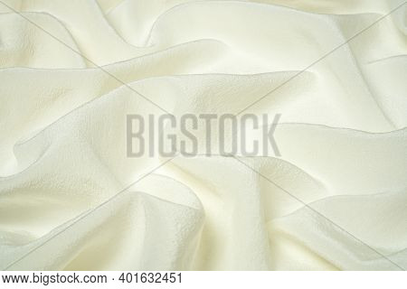 Premium Quality White Natural Silk Fabric With Waves And Folds. Beautiful Silk Background, Side View