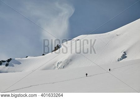 Two climbers walking on glacier