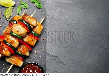 Delicious Chicken Shish Kebabs With Vegetables On Black Table, Flat Lay. Space For Text