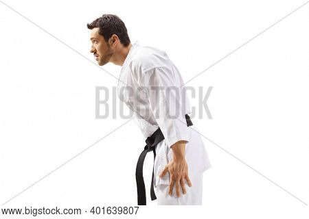 Man with black karate belt bowing isolated on white background