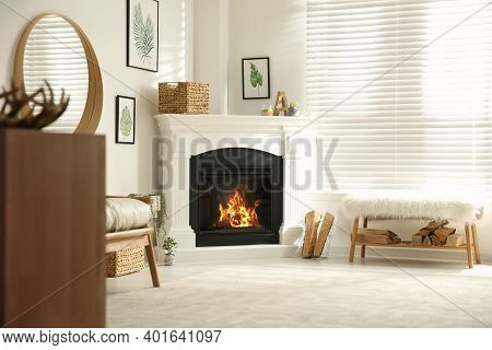 Bright Living Room Interior With Artificial Fireplace And Firewood
