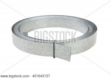 Galvanized Metal Strip In A Roll. Isolated. White Background.