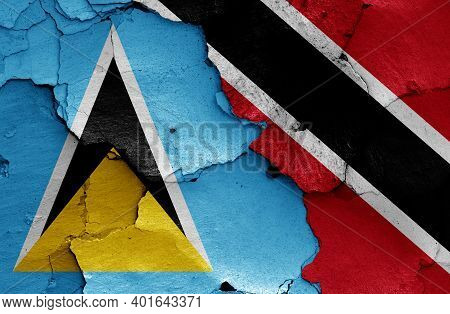 Flags Of Saint Lucia And Trinidad And Tobago Painted On Cracked Wall