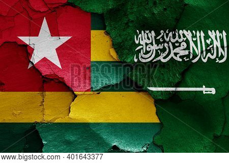 Flags Of Togo And Saudi Arabia Painted On Cracked Wall