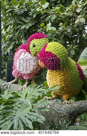 Singapore - Dec 31, 20120: Colorful Birds Located In Topiary Walk At Jewel Changi Airport. Canopy Pa