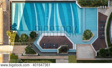 Bangkok, Thailand - 02 Jan 2020 : Top Down Aerial View Of Outdoor Swimming Pool Surrounding Palms An