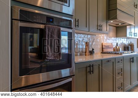 Interior Of Home With Oven And Cooking Area Inside The Kitchen With Cooktop