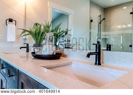 Double Sink Bathroom Vanity With Black Faucet And White Countertop Over Cabinets