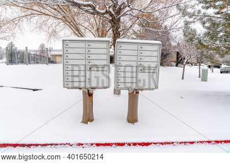 Cluster Mailbox On Snow Covered Roadside Of Residential Neighborhood In Winter