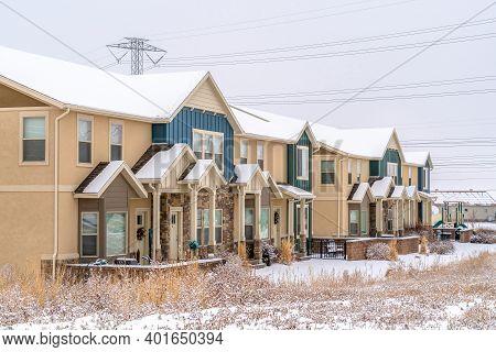 Facade Of Apartments With Bay Windows Small Porches And Gable Entrances
