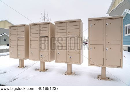 Cluster Mailboxes With Compartments For Residents Of A Snowy Neighborhood
