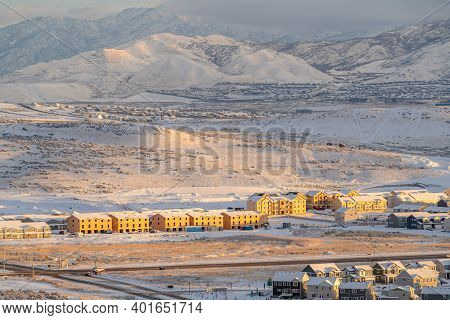 Homes Apartments And Townhouses With View Of Mountain On A Winter Landscape