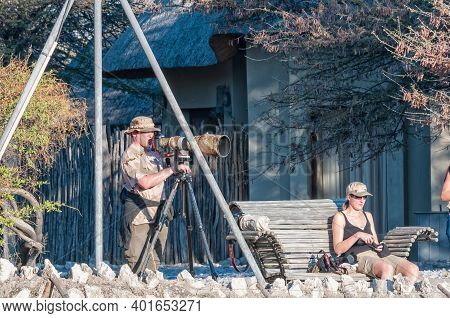 Etosha National Park, Namibia - June 13, 2012: Photographers At The Waterhole Viewpoint At Okaukeujo