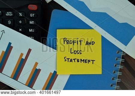 Profit And Lost Statement Write On Sticky Notes Isolated On Wooden Table. Business Or Finance Concep