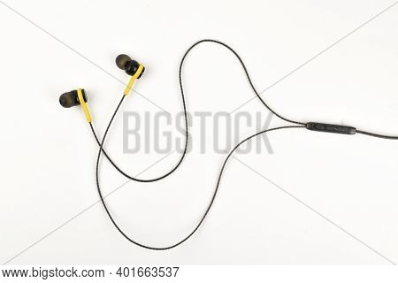 Top View Of Earphone With Volume Rocker Button Isolated On White Background
